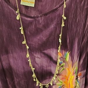 Kendra Scott necklace with silver tones